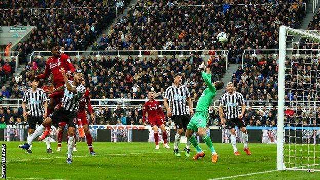Divock Origi heads in Liverpool's winner against Newcastle
