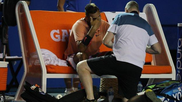 Nick Kyrgios looking dejected while receiving treatment on his left wrist during a medical timeout at the Mexican Open