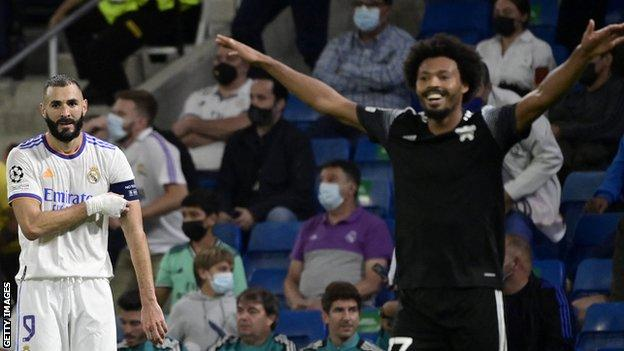 Real Madrid's French forward Karim Benzema looks at the celebration of Sheriff's Brazilian midfielder Bruno Felipe Souza da Silva