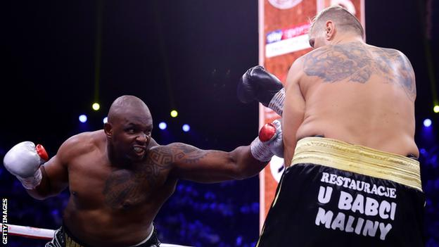 Dillian Whyte unleashing some of his trademark 'body snatcher' punches against Mariusz Wach in Saudi Arabia in December 2019