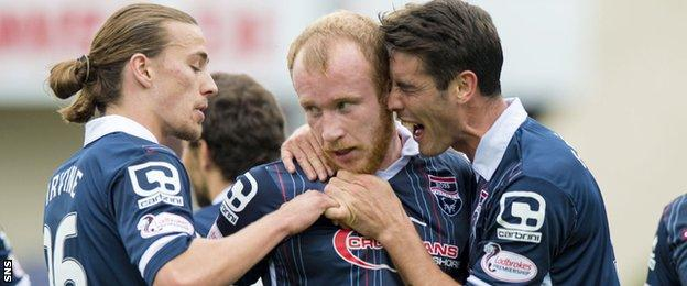 Liam Boyce (centre) is congratulated after giving Ross County the lead