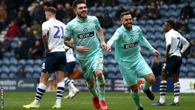 Ryan Manning, pictured here celebrating with former Swansea City star Angel Rangel, was linked with West Ham during the transfer window