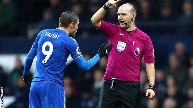 Bobby Madley speaks to Leicester striker Jamie Vardy