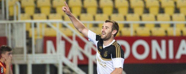 Aberdeen's Niall McGinn celebrates after opening the scoring