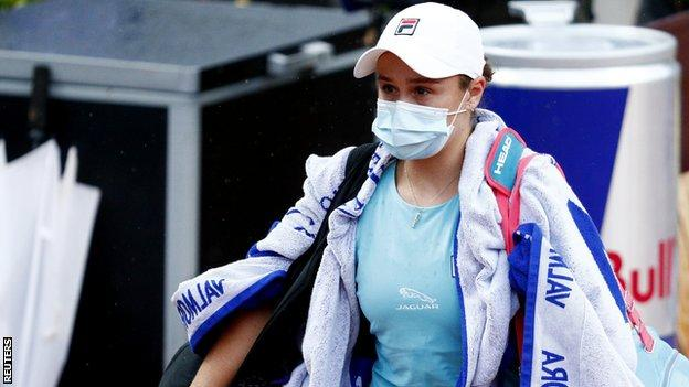 Ashleigh Barty walks off court after retiring injured in the Italian Open