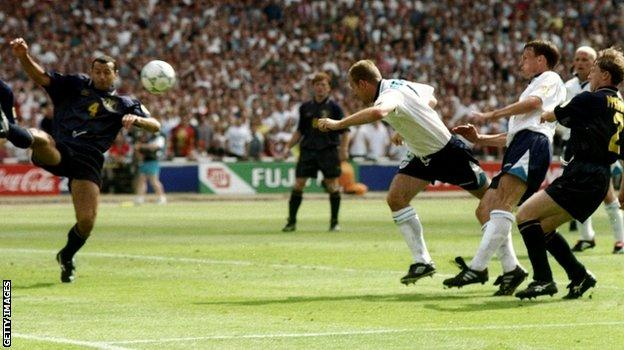 Alan Shearer scores England's first goal against Scotland