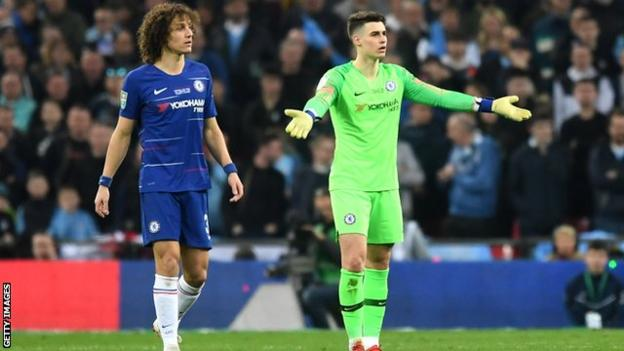 Chelsea goalkeeper Kepa Arrizabalaga (right) refuses to be substituted during the Carabao Cup final