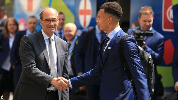 Tottenham player Dele Alli is greeted by the Mayor of Chantilly, Eric Woerth