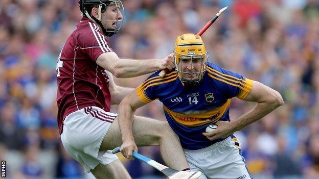 Galway's Padraig Mannion battles with Tipperary's Seamus Callanan