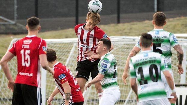 Candystripes midfielder Greg Sloggett rises highest to head clear against the leaders