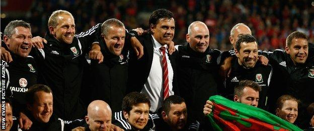 Chris Coleman and his Wales back room staff celebrate