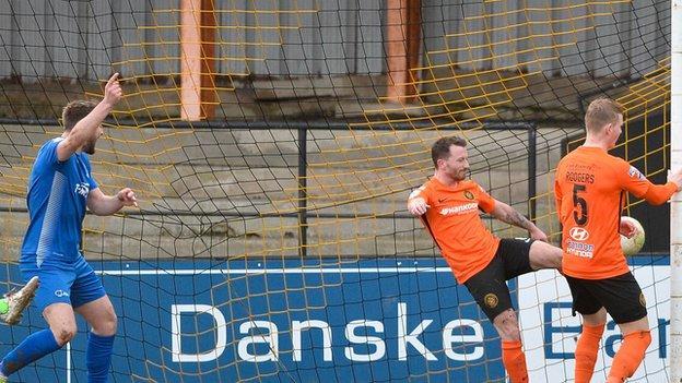 Douglas Wilson celebrates putting Dungannin in front against Carrick