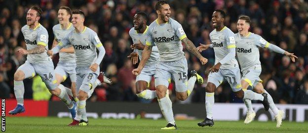 Derby's players rush to acclaim their penalty shoot-out win against Manchester United