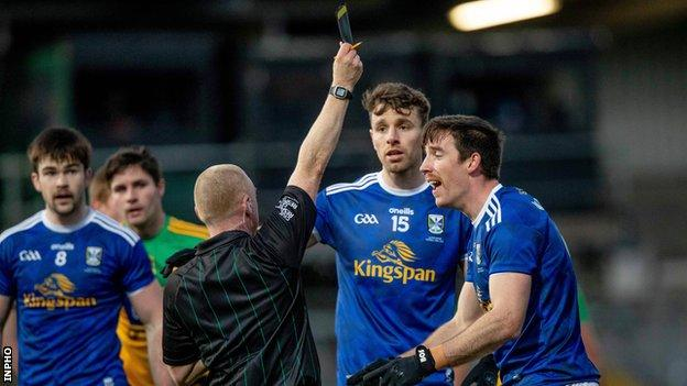 Cavan protest after Killian Brady is black carded by referee Barry Cassidy