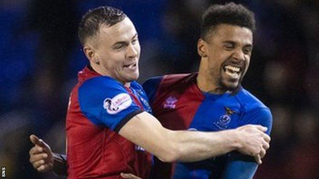Inverness Caledonian Thistle players Darren McCauley and Nathan Austin celebrate their win over Ross County