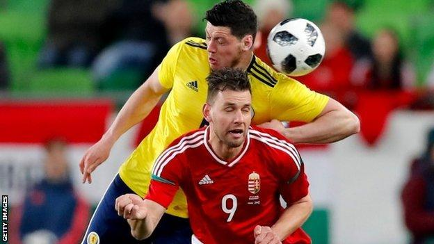Scott McKenna competes for a header with Hungary's Adam Szalai