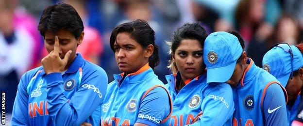 India's players look dejected after defeat against England