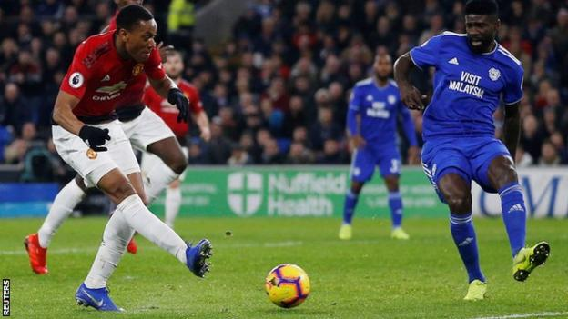 Anthony Martial scores United's third goal