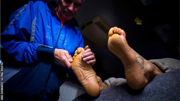 A competitor receives a foot massage