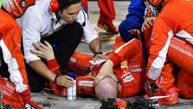 A Ferrari lies injured after a pit stop in 2018