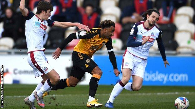 Newport's Nicky Maynard is tackled by Jordan Williams