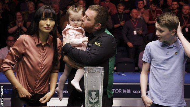 Mark Allen celebrates with his family after landing the £70,000 top prize in Glasgow