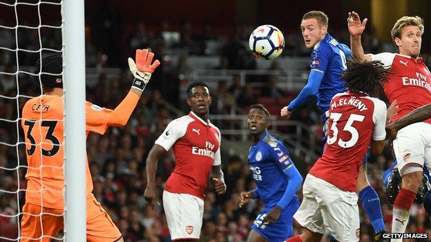 Jamie Vardy heads Leicester in front against Arsenal