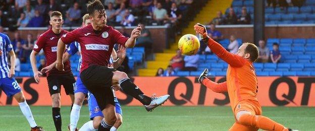 Jamie MacDonald blocks Danny Mullen's close-range shot