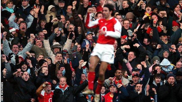 Robert Pires celebrates scoring for Arsenal in front of his team's fans