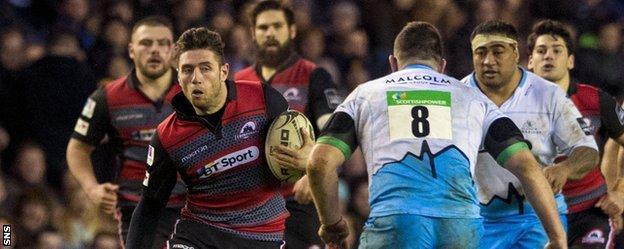 Edinburgh's Jack Cuthbert tries to break through the Glasgow defence