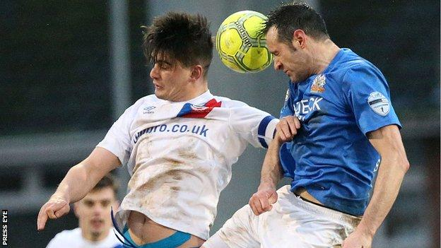 Jimmy Callacher and Ciaran Martyn in aerial action as Linfield beat Glenavon 2-1 in January