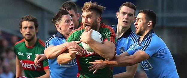 Aidan O'Shea is surrounded by Dublin defenders after winning the ball