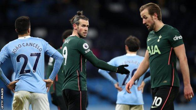 Gareth Bale talks to his Tottenham team-mate Harry Kane during Saturday's defeat by Manchester City