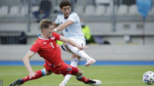 Che Adams' second international goal had Scotland ahead at half-time