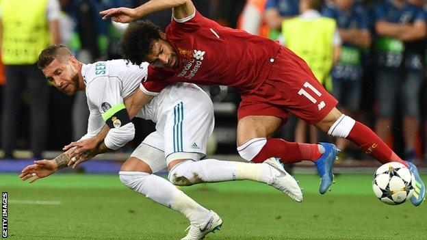 Liverpool forward Mohamed Salah had to go off with a shoulder injury after a challenge with Sergio Ramos during the first half of the 2018 Champions League final against Real Madrid