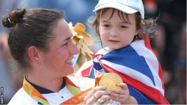 Sarah Storey and her daughter Louisa hold her gold medal at the 2016 Rio Paralympics