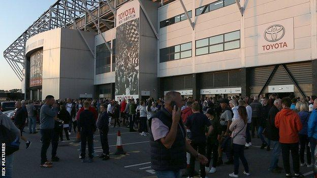 Fans outside Pride Park during an evacuation
