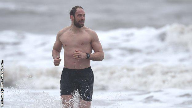 Alun Wyn Jones takes part in an Ospreys sea recovery session at Aberavon beach