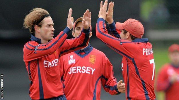 Jersey bowler Corne Bodenstein celebrates taking a wicket