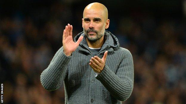 Manchester City manager Pep Guardiola applauds the crowd after a Premier League win