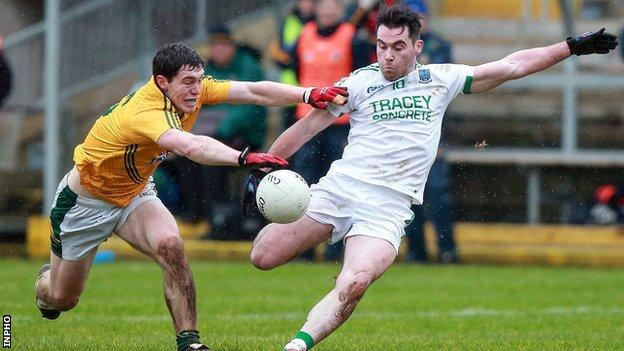 Meath's Padraic Harnan attempts to get a block in as Fermanagh forward Barry Mulrone takes a shot