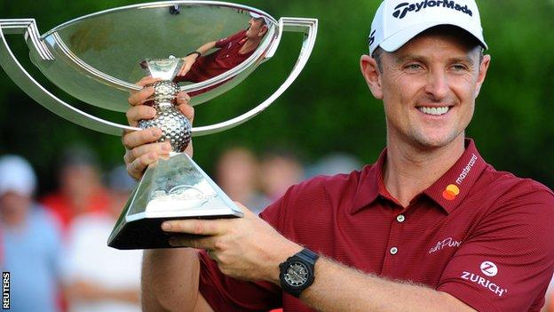 Justin Rose celebrates with the FedEx Cup