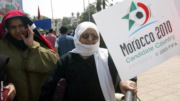 Moroccan women with a 2010 World Cup bid poster
