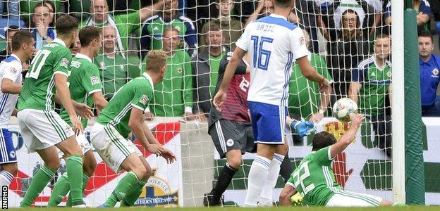 Will Grigg's stoppage-time goal could not save Northern Ireland from defeat in Belfast