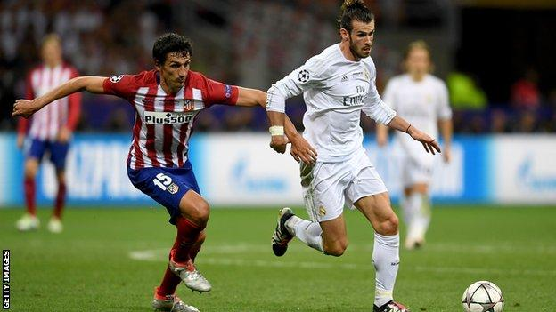 Real Madrid's Gareth Bale (right) and Atletico Madrid's Stefan Savic
