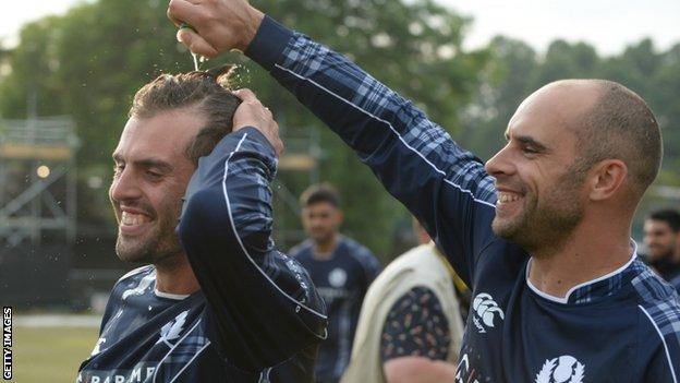 Scotland's Calum MacLeod (left) celebrates with captain Kyle Coetzer