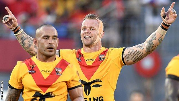 Luke Page celebrates a World Cup win for PNG