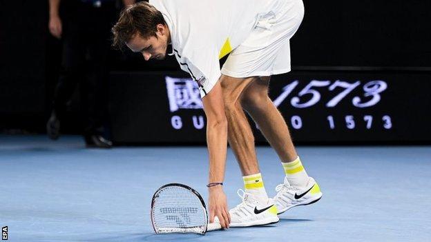 Daniil Medvedev picks up broken racquet during Australian Open final