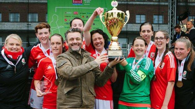 Michael Sheen helps the Wales women's team celebrate their tournament win
