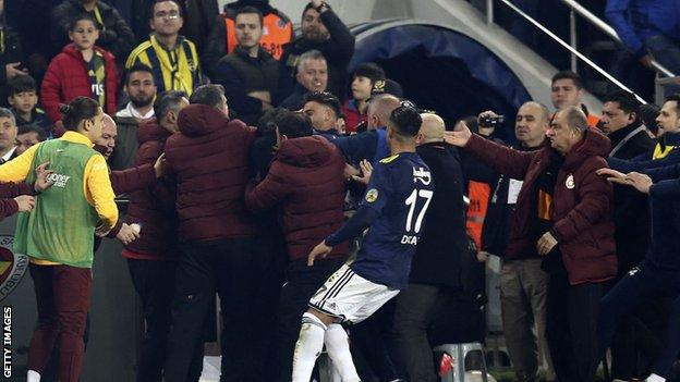 Fenerbahce and Galatasaray players clash on the touchline